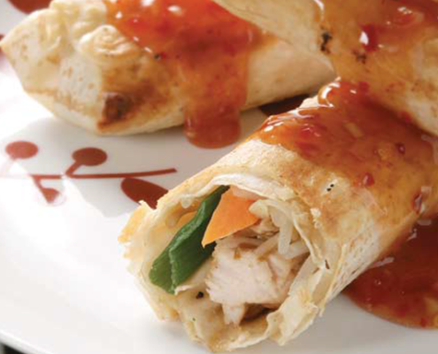 Three-chicken-and-vegetable-rolls-wrapped-in-Mountain-Bread-covered-in-sweet-chilli-sauce.