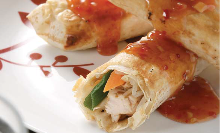 Three-chicken-and-vegetable-rolls-wrapped-in-Mountain-Bread-covered-in-sweet-chilli-sauce