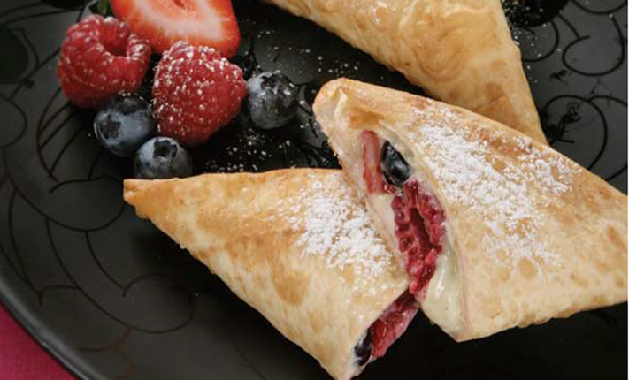 Mountain-Bread-Raspberry-and-blueberry-triangles-with-creamed-cheese-dusted-with-sugar.